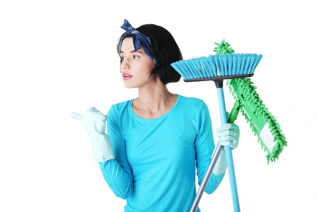 This is a picture of a lady holding some cleaning tools.